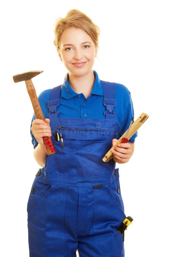 妇女作为工匠或住所改善 免版税库存照片