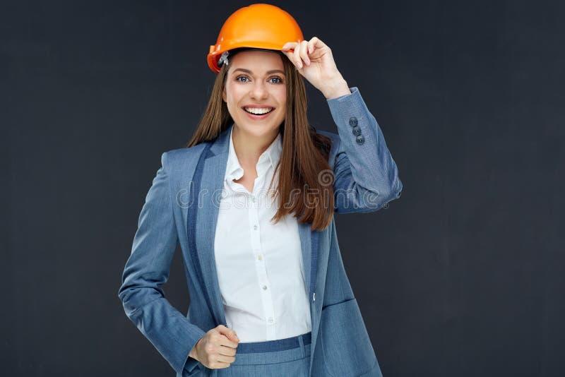 妇女佩带灰色西装神色successf的建筑师建造者 库存照片