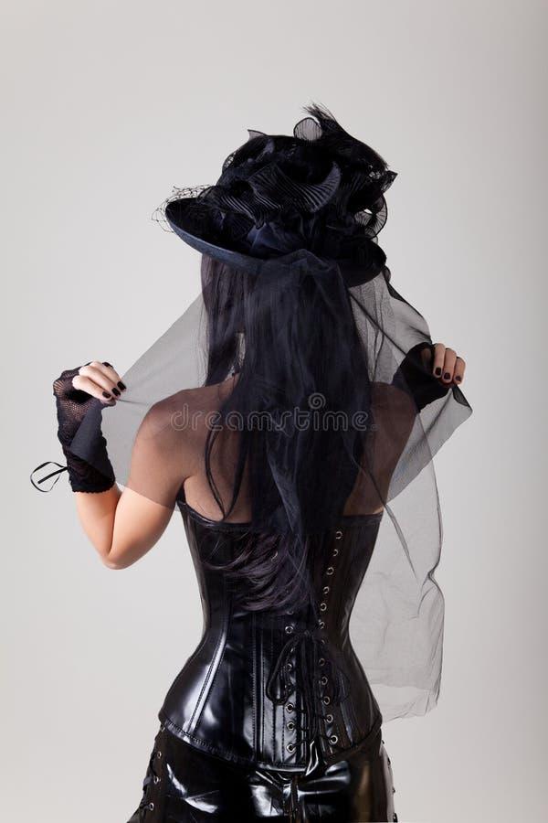 妇女佩带的腰部训练束腰背面图  库存照片