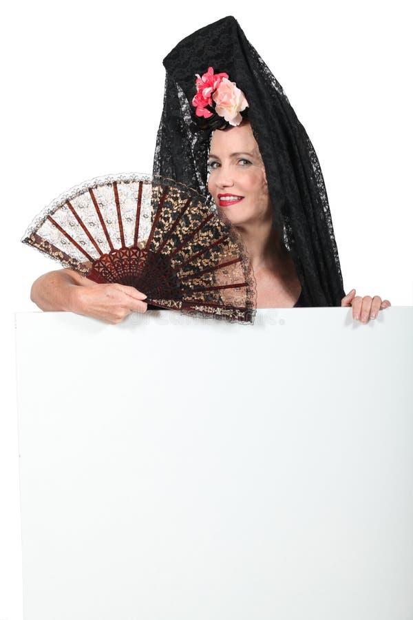 妇女佩带的连披肩之头纱 免版税库存照片