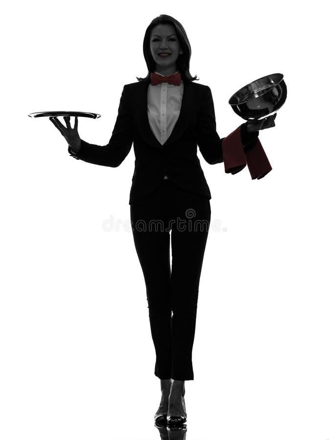 妇女侍者男管家开头承办酒席圆顶剪影 免版税库存照片