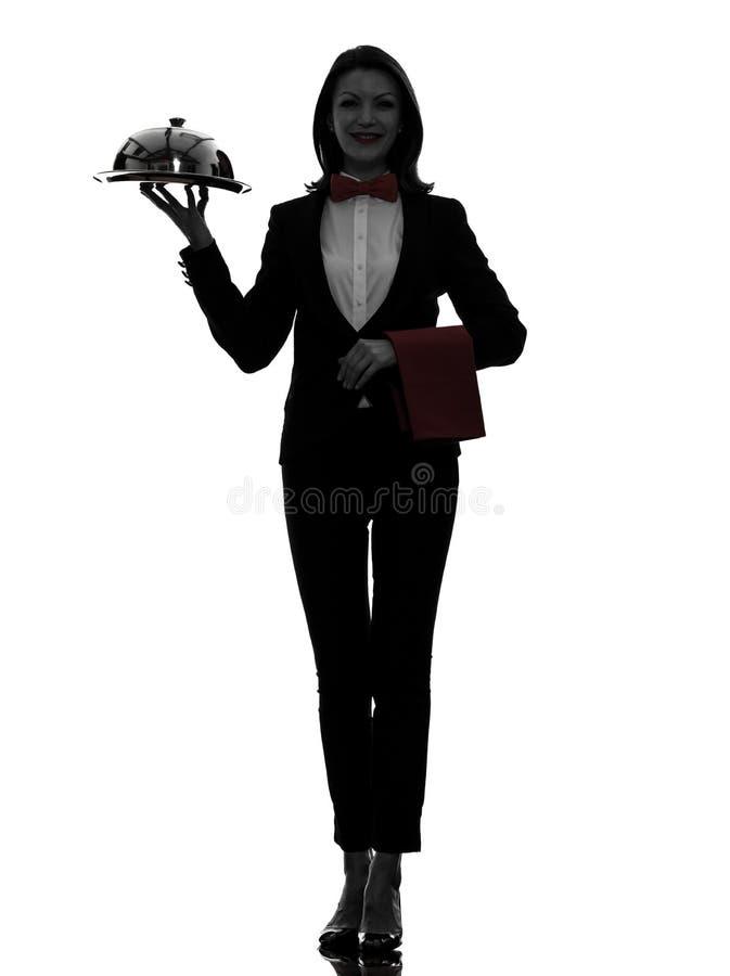 妇女侍者男管家服务晚餐剪影 图库摄影