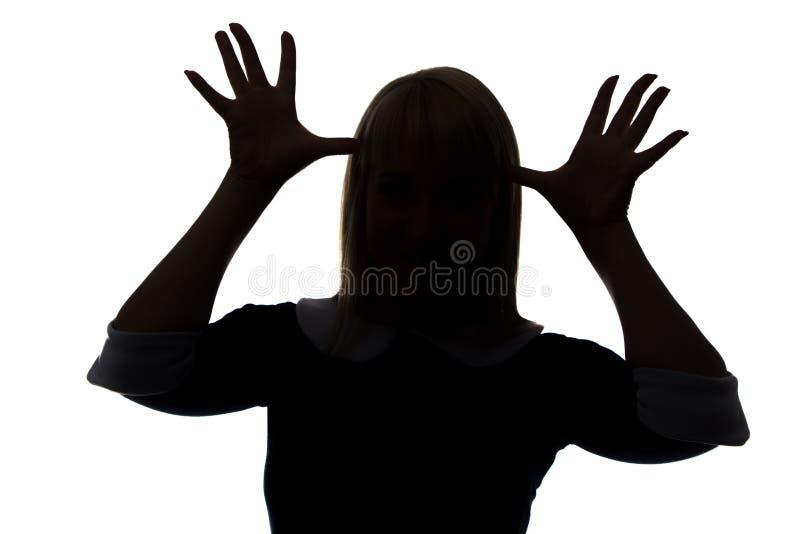 妇女剪影有棕榈的在头 免版税库存图片