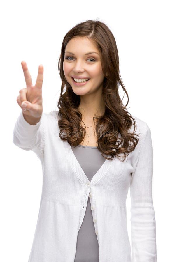 妇女和平打手势 免版税库存图片