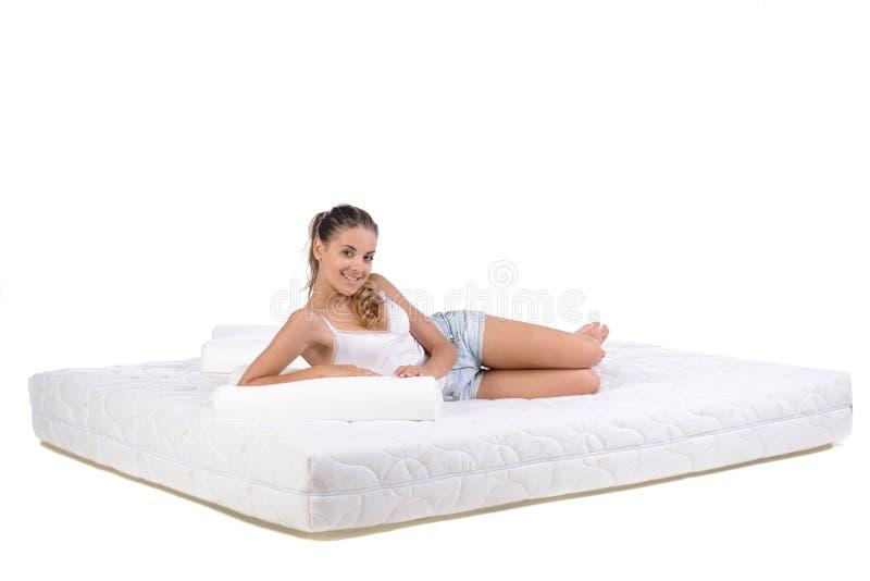 妇女和床垫 库存图片
