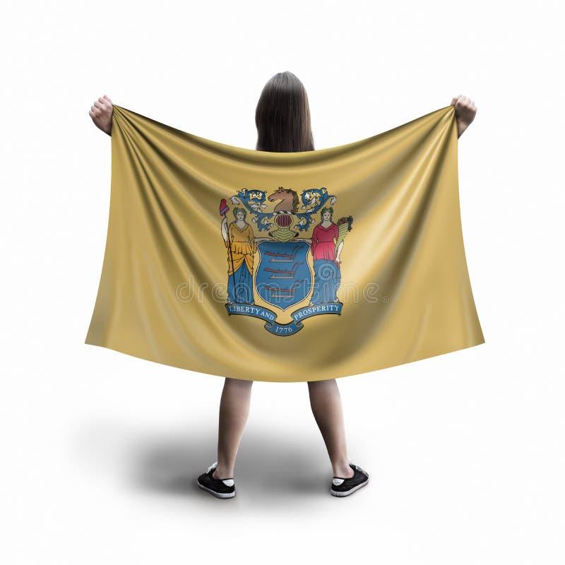 妇女和新罕布什尔旗子 免版税图库摄影