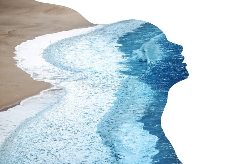 妇女和海洋外形  库存照片