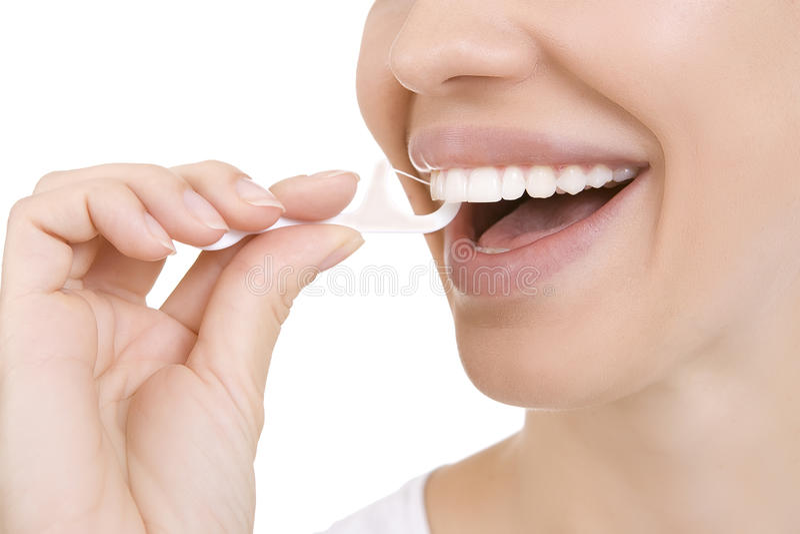 妇女和牙绣花丝绒(牙签) 免版税图库摄影