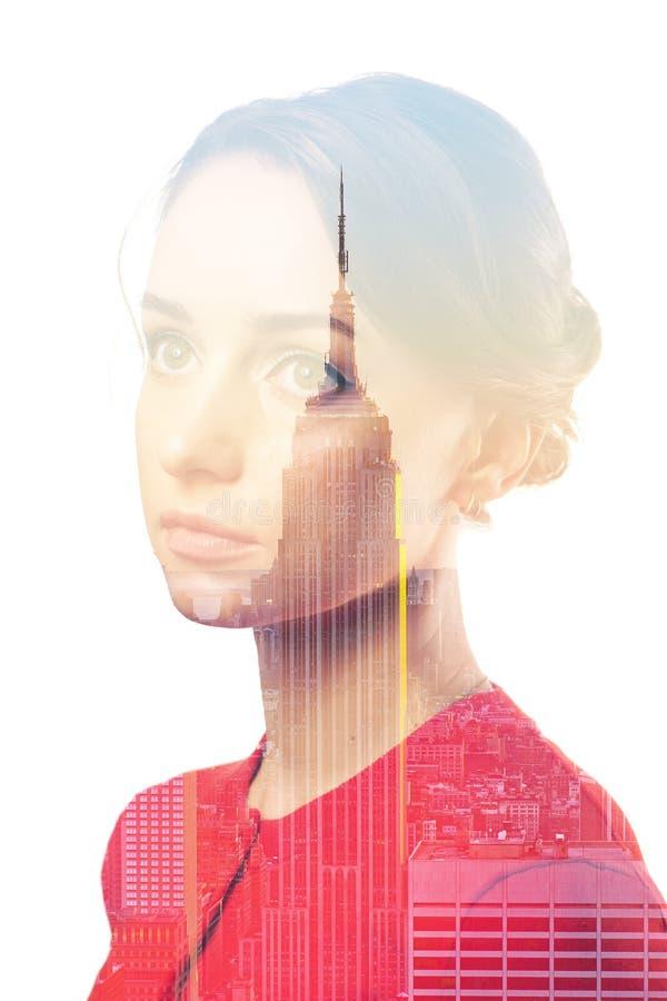 妇女和纽约地平线两次曝光画象  免版税库存照片