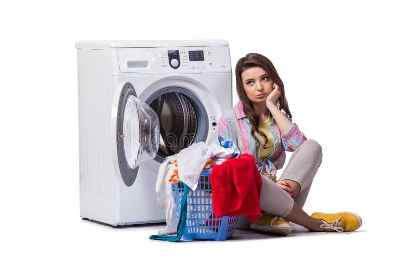 妇女在做在白色隔绝的洗衣店以后疲倦了 免版税图库摄影