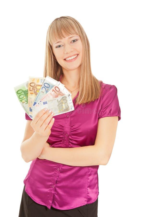 妇女在她的手上的拿着欧元钞票隔绝在白色 库存图片