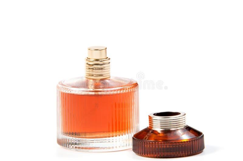 妇女在白色隔绝的美丽的瓶的` s香水 库存照片