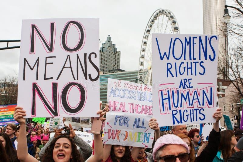 妇女在社会正义的亚特兰大3月阻止标志 图库摄影