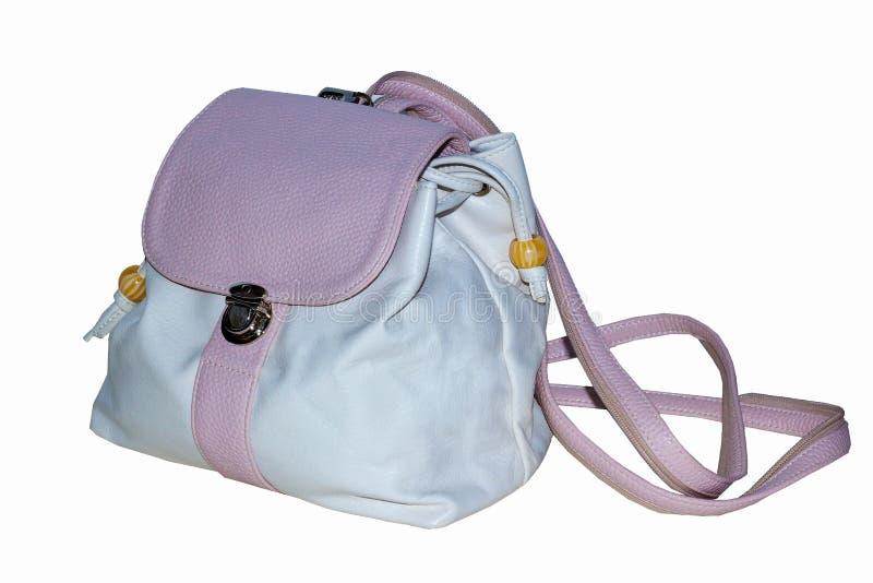 妇女在软的桃红色颜色的` s背包与皮带和可锁定的盒盖 免版税库存图片