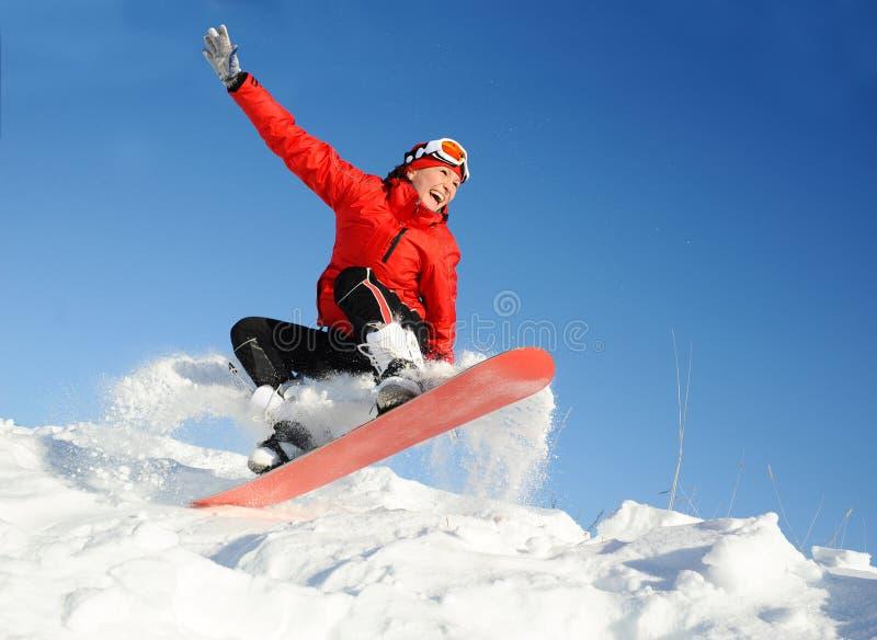 妇女在雪板的作为乐趣 免版税图库摄影