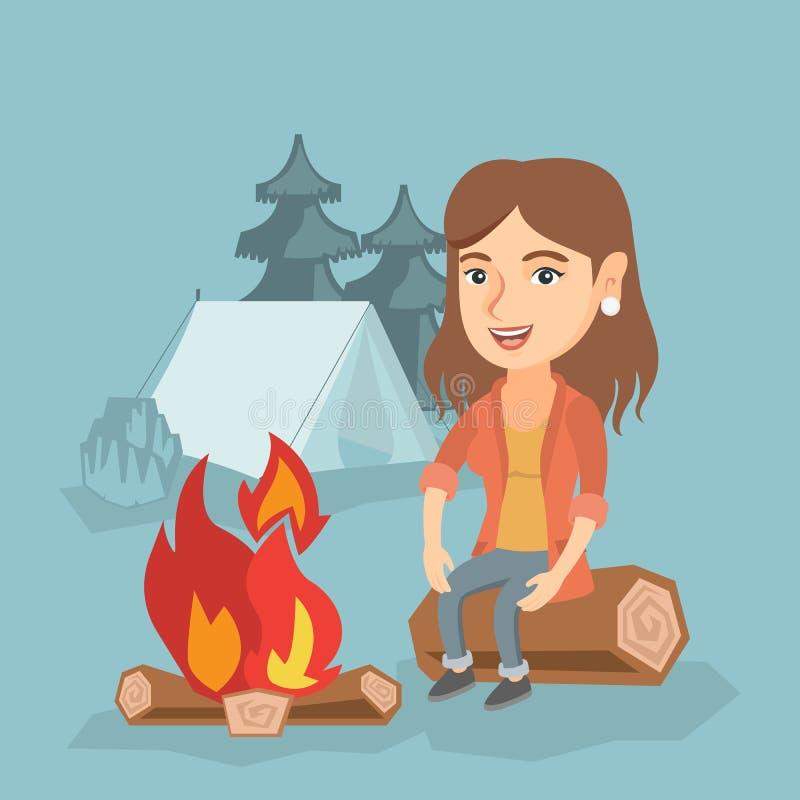 妇女坐日志在野营的营火附近 向量例证