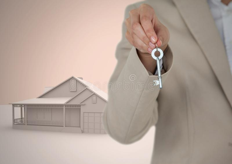 妇女对负关键与3D在小插图前面的房子模型 库存照片