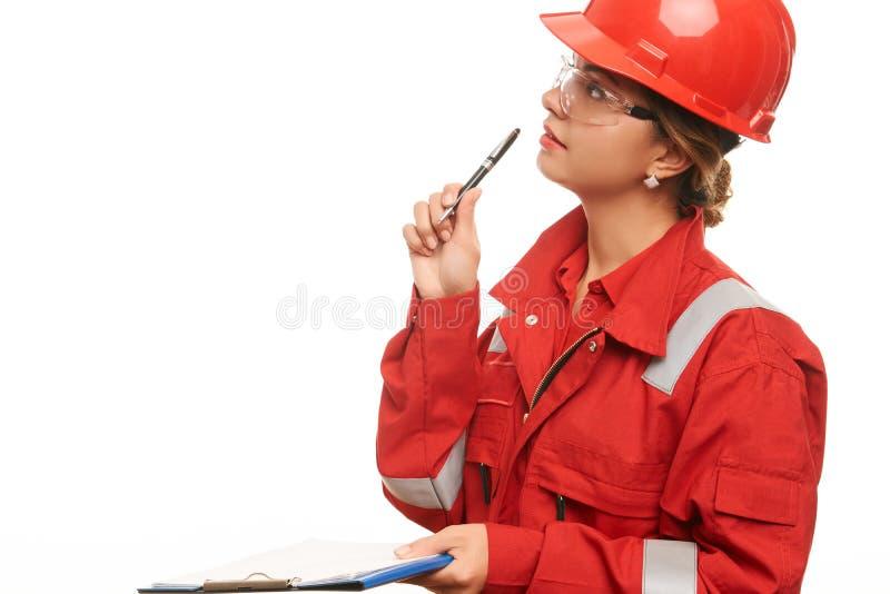 妇女工程师和建筑工人 库存照片