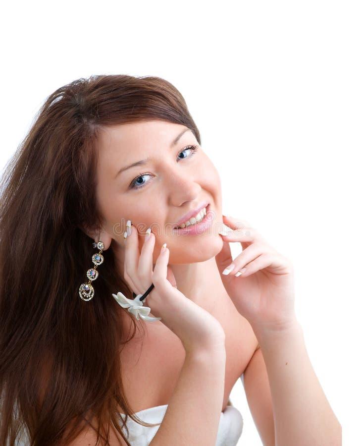 妇女年轻人的秀丽接近的表面纵向 免版税库存图片