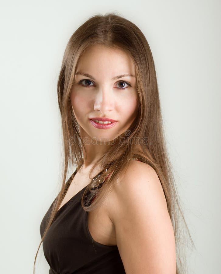 妇女年轻人的秀丽接近的表面纵向 免版税库存照片