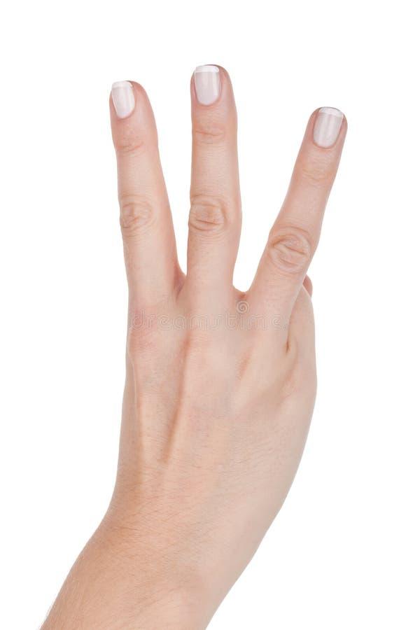 妇女手显示三个手指 免版税库存图片
