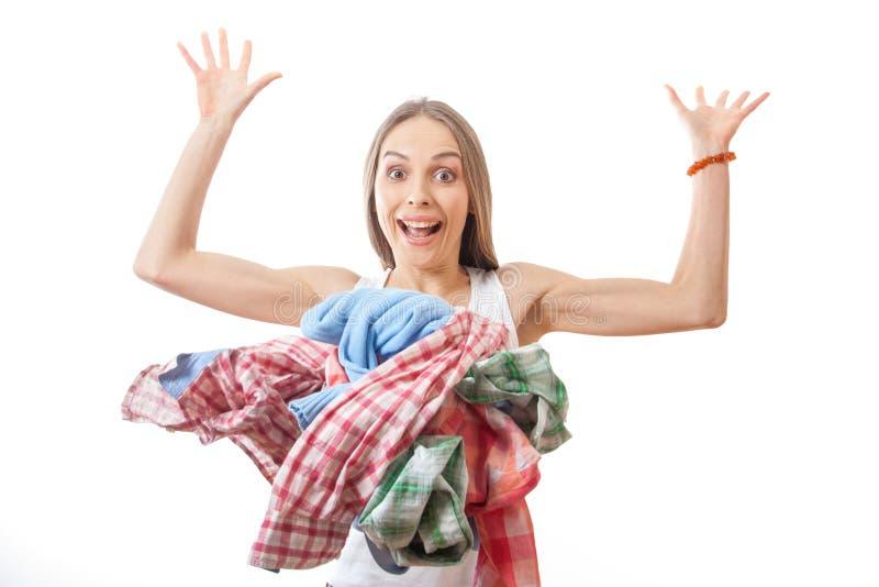 妇女投掷堆衣裳,隔绝在白色 免版税图库摄影