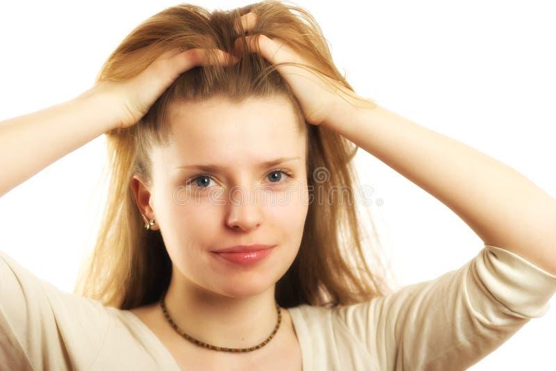 妇女掠过的头发 库存照片