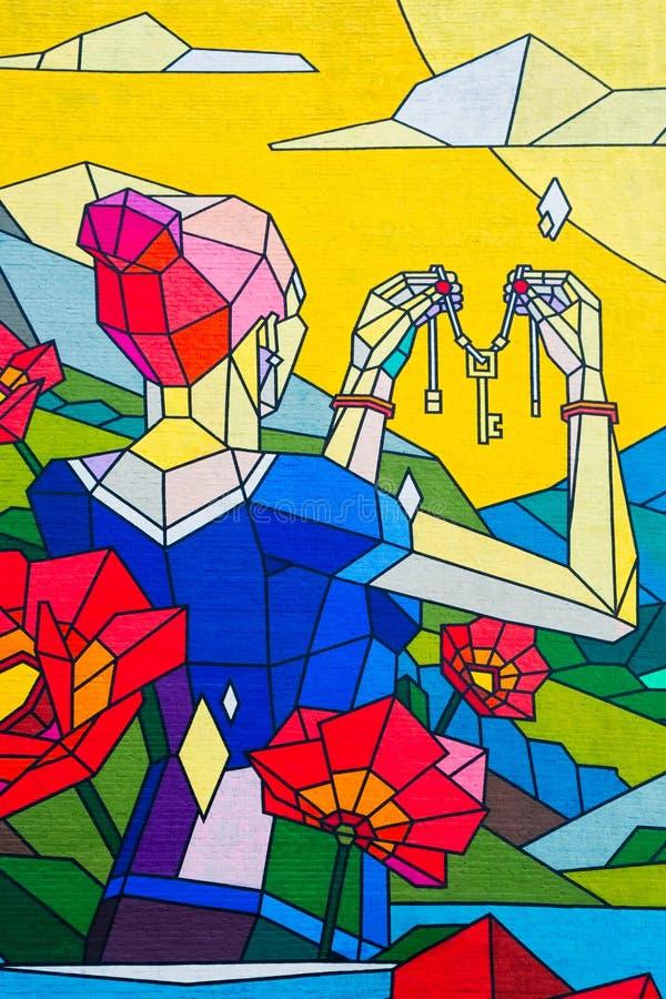 妇女春天夏天自然在手中开花天空空间,在墙壁上的图象,街道画,钥匙,自然礼物  皇族释放例证