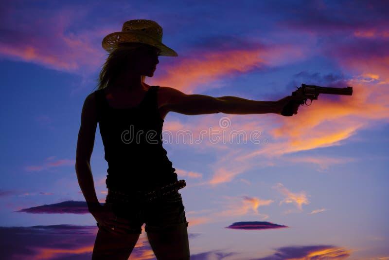 妇女枪剪影 图库摄影