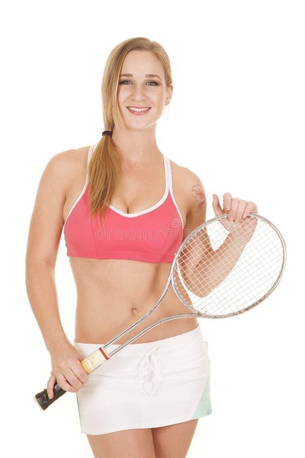 妇女桃红色胸罩裙子网球raquet举行 免版税库存照片