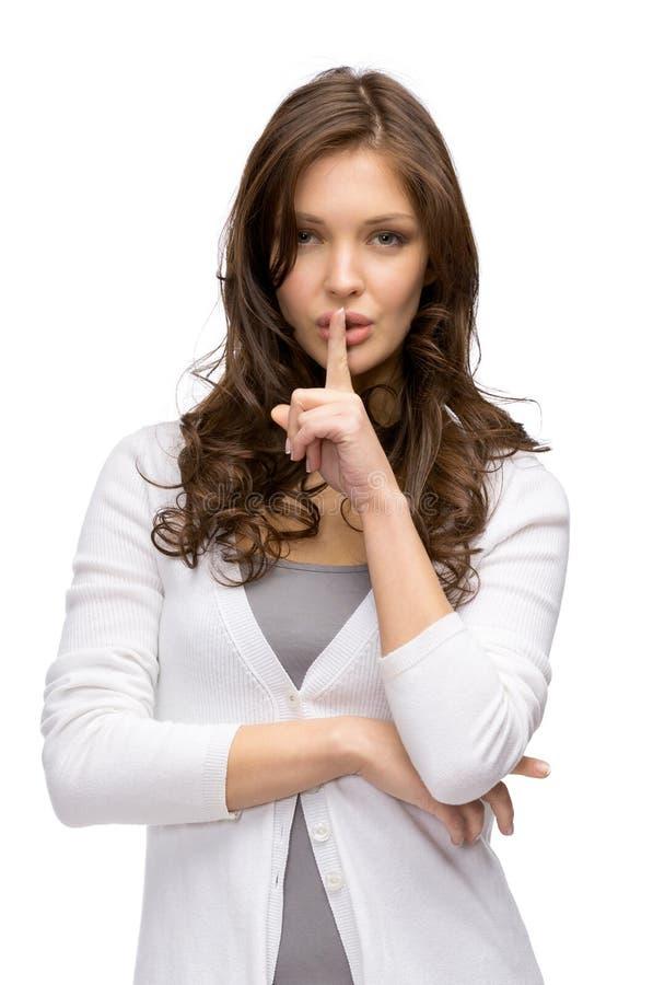 妇女沈默打手势 库存照片