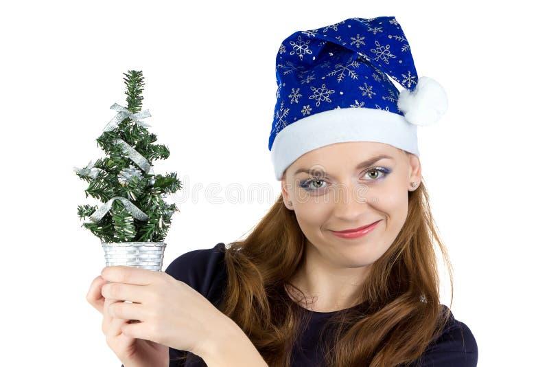 妇女照片有小圣诞树的 免版税图库摄影