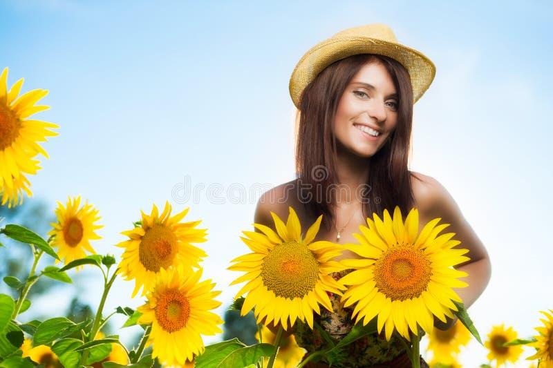 妇女用向日葵 免版税图库摄影