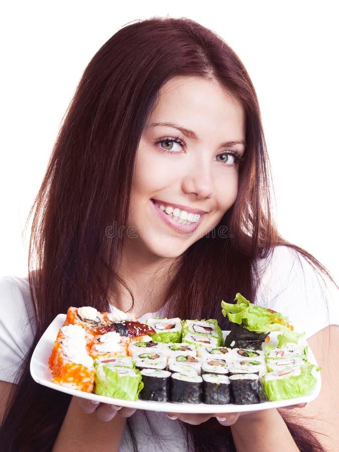 妇女用寿司 库存图片