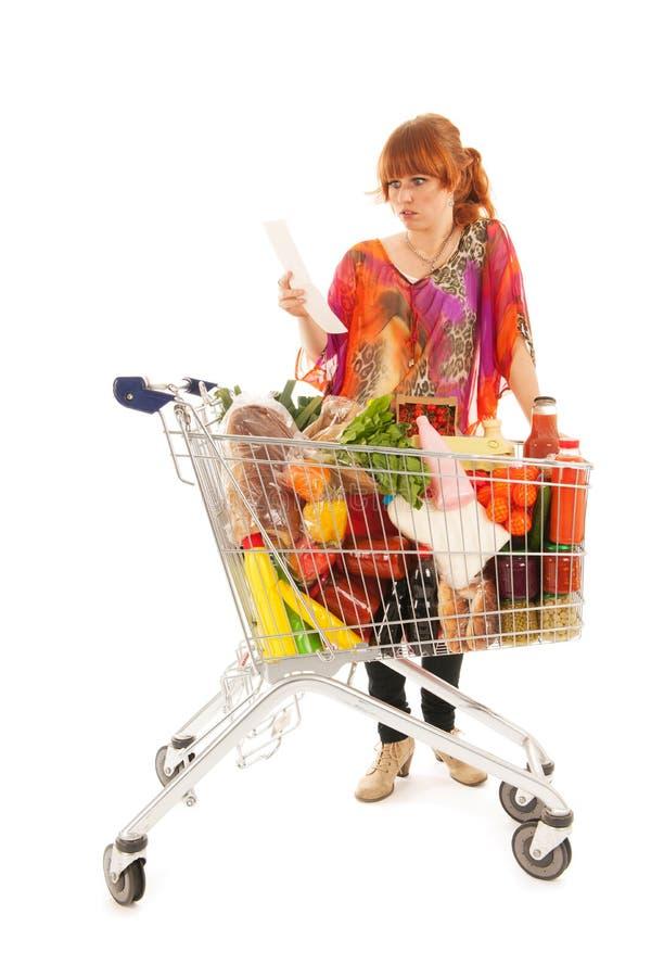 妇女用购物车充分的牛奶店杂货 免版税库存图片