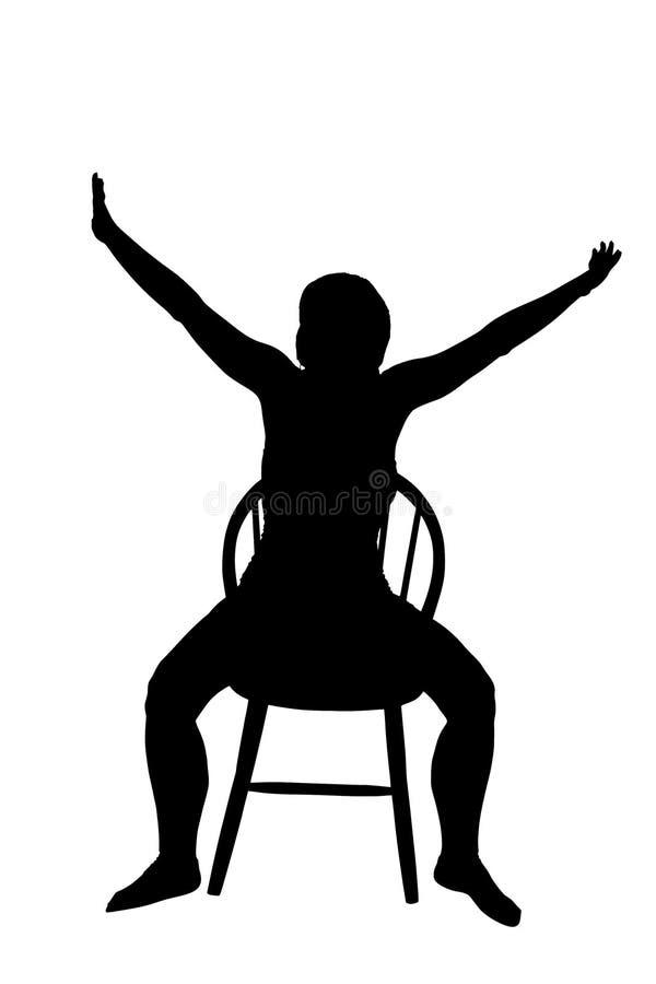 妇女的剪影坐椅子 免版税库存图片