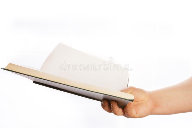 妇女的手拿着书 库存图片