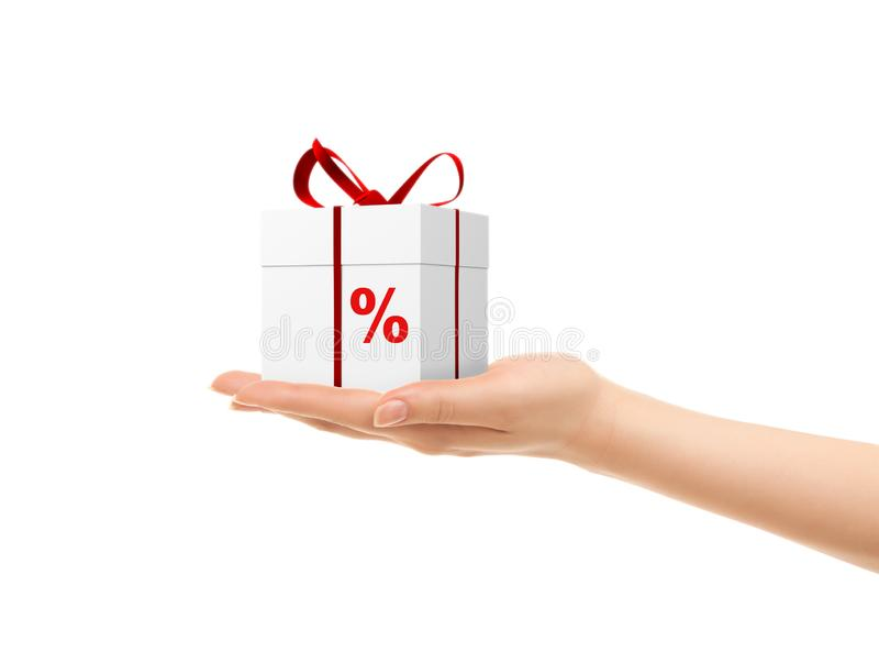 妇女的手的图片拿着礼物盒的 礼物的百分之 免版税库存图片
