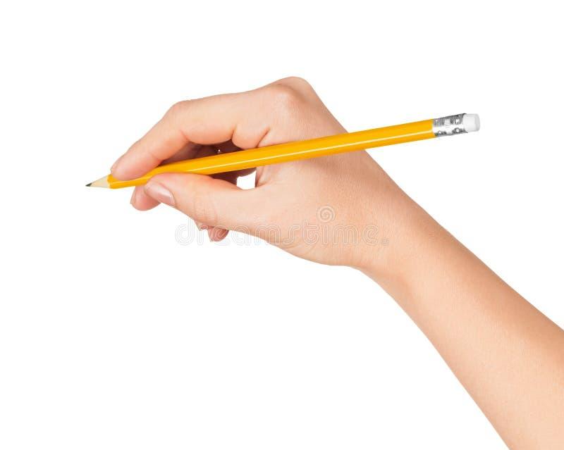 妇女的手画铅笔 免版税库存图片