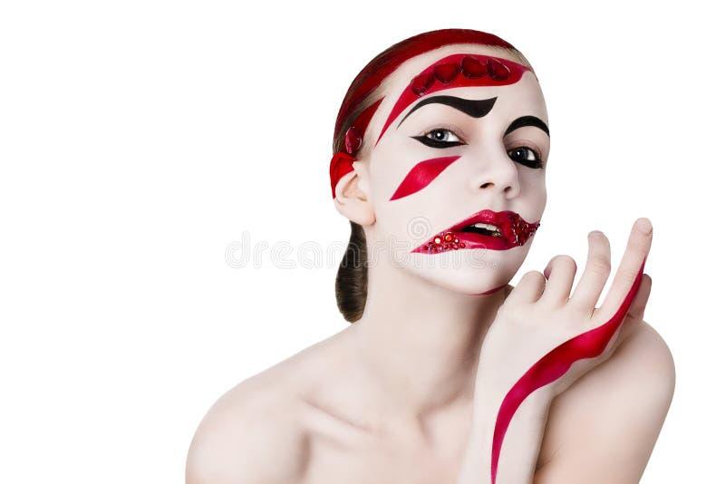 妇女的演播室画象 在红色的艺术构成 免版税库存照片