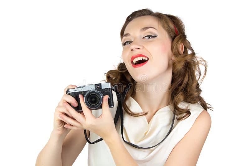 妇女的照片有减速火箭的照相机的 免版税库存图片