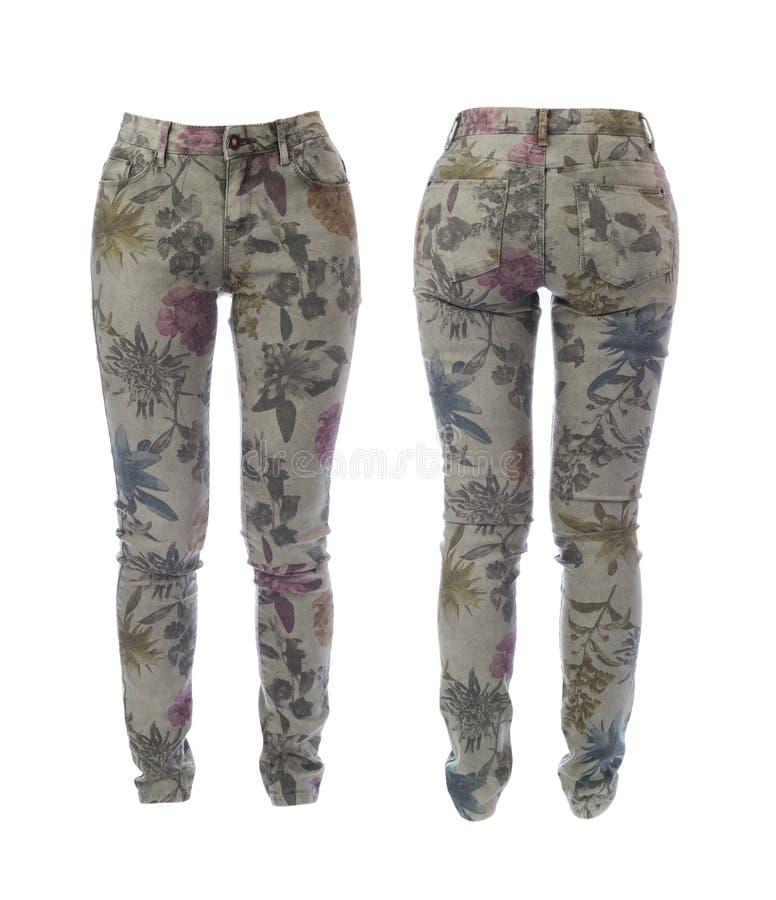 妇女的牛仔裤拼贴画有花卉样式的。在白色的孤立。 库存图片