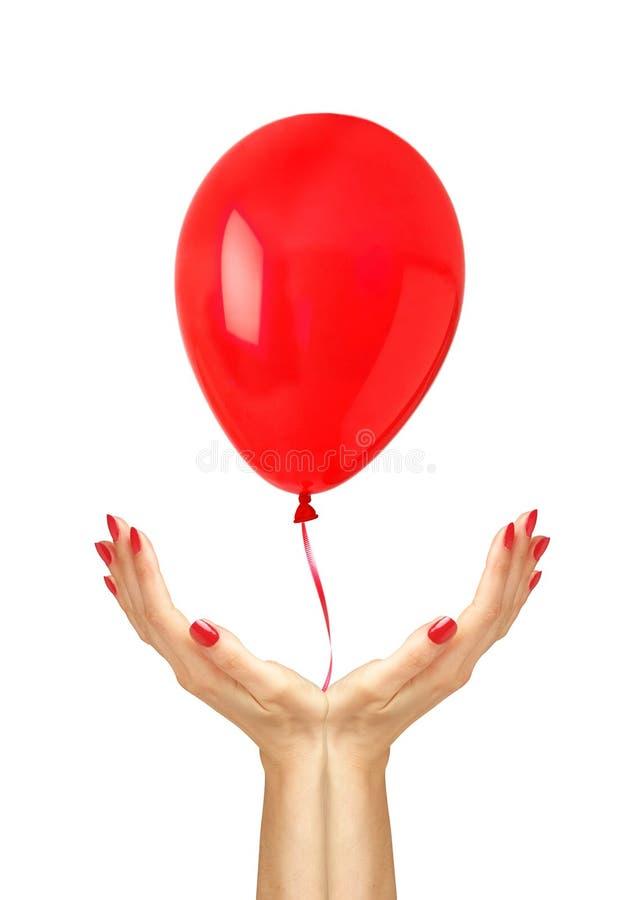 从妇女的红色愉快的空气腾空球飞行移交白色 免版税库存照片