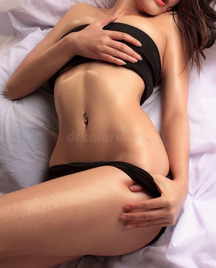 妇女的美好的亭亭玉立的身体 免版税库存照片