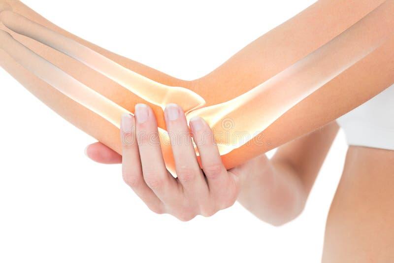 妇女的被突出的骨头充满手肘痛苦的 免版税库存图片