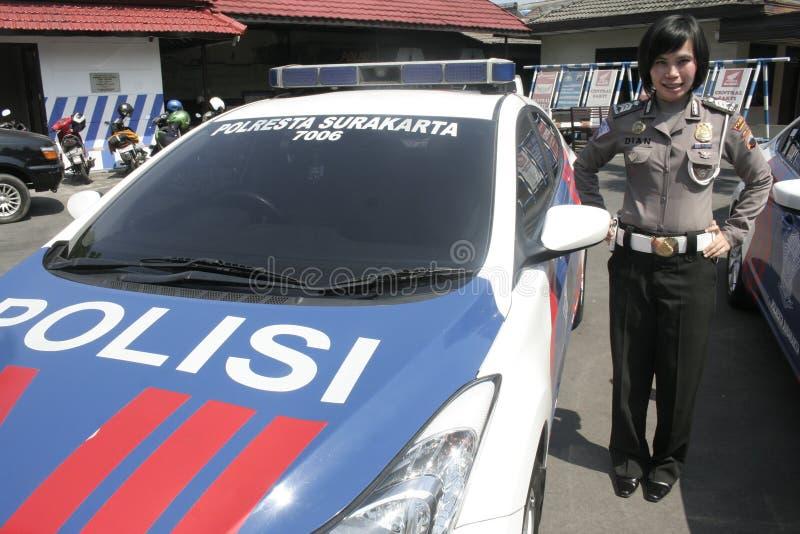 妇女的集体一致的警察局巡逻车 图库摄影