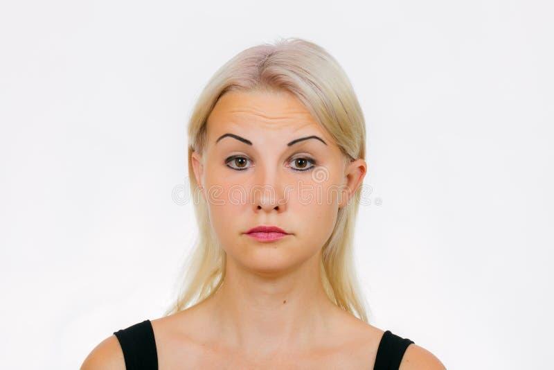 妇女的面孔锻炼结冰 免版税库存图片