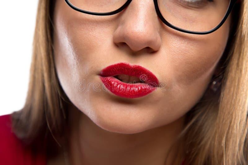 妇女的面孔,红色嘴唇照片  免版税库存图片