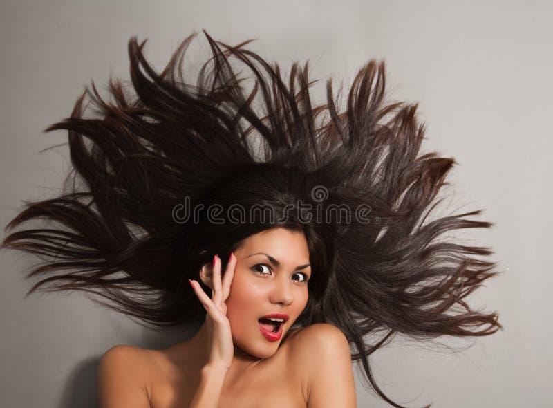 妇女的黑色接近的头发 图库摄影