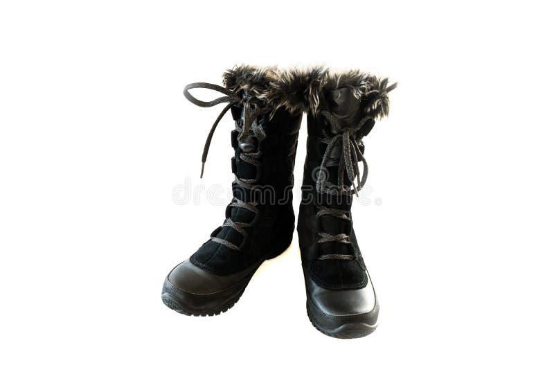 妇女的黑雪地靴 免版税库存图片